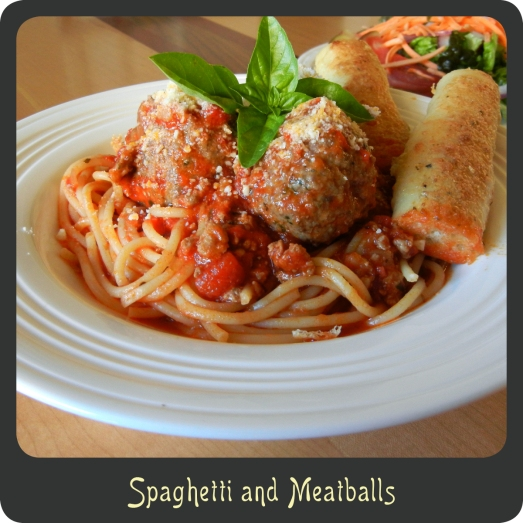 Marinara sauce tossed with spaghetti and meatballs and topped with parmesan cheese